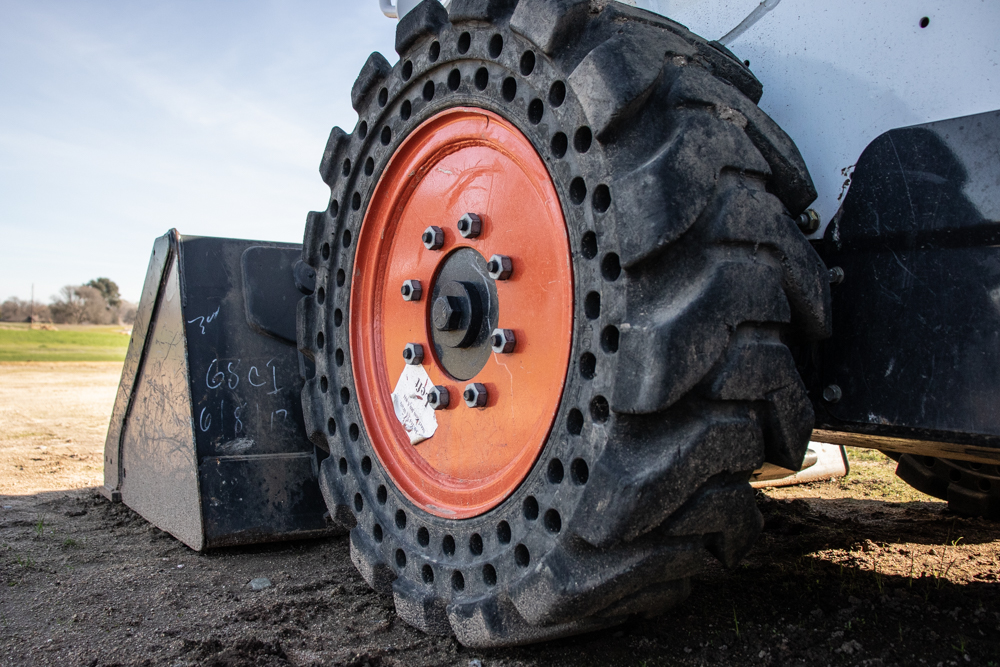 Wheels or Tracks for Skid Steers?