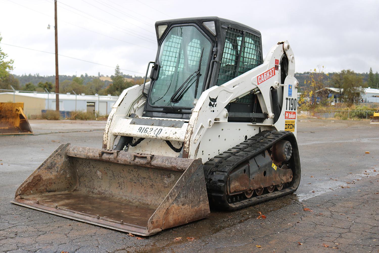 Mini Excavator or Skid Steer?
